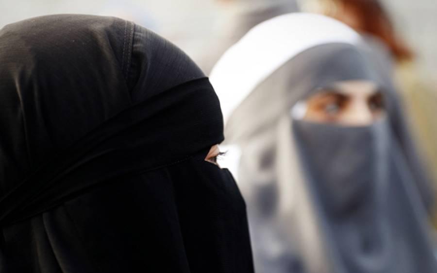 وہ ملک جہاں اب فیس ماسک پہننا لازمی ہے لیکن برقعہ پر پابندی ہے