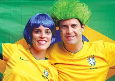 اولمپکس میں شریک برازیلین تماشائیوں کا فوٹو گرافروں کے لئے خصوصی پوز