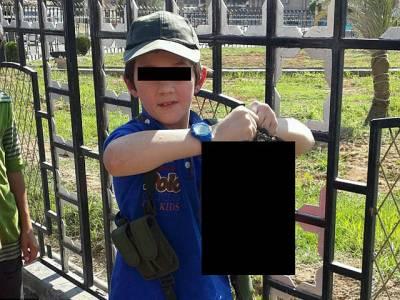سات سالہ بچے کے ہاتھ میں کٹا ہوا سر