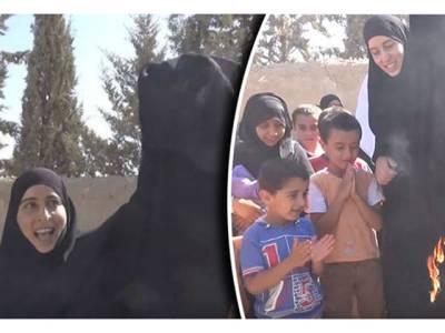 عرب ملک میں یہ خاتون برقعہ کو آگ کیوں لگارہی ہے؟ حقیقت جان کر آپ کا بھی دل افسردہ ہوجائے گا