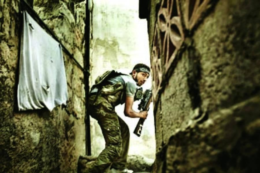 دمشق: شامی باغی سرکاری فوج پر حملہ کررہاہے