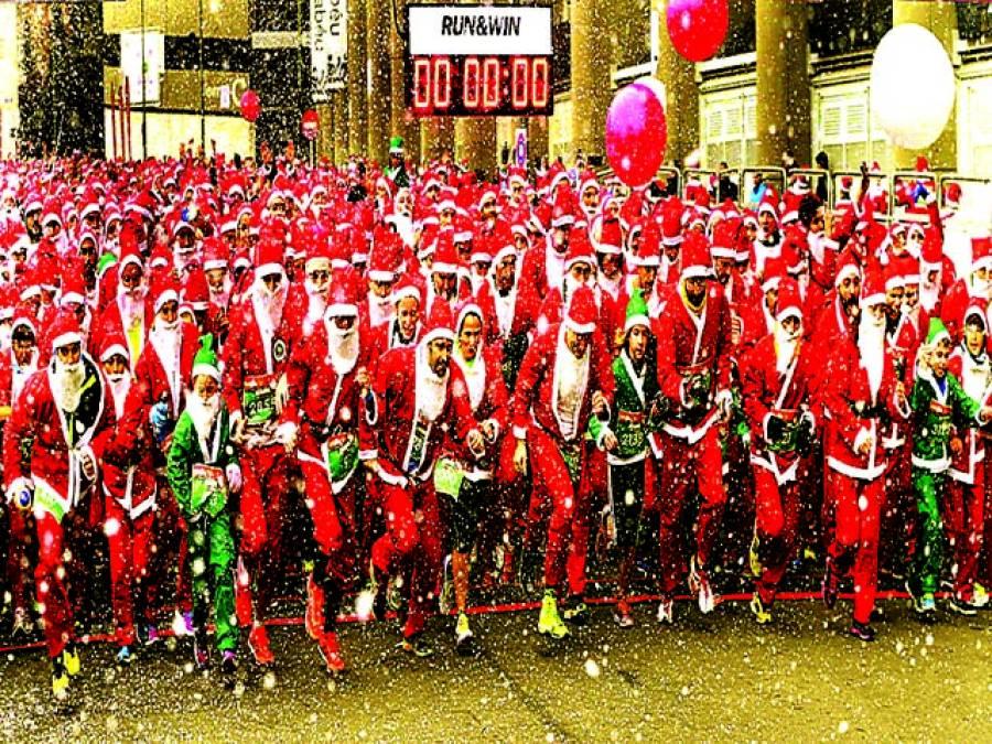 پیرس: لوگ سانتا کلاز کا لباس پہنے دوڑ لگا رہے ہیں