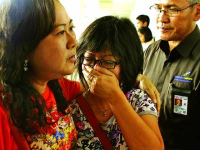 کوالالمپور: لاپتہ ملائیشین طیارے کے مسافروں کے عزیز اپنے پیاروں کی یادمیں غمزدہ ہیں