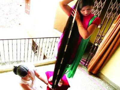 37سالہ بھارتی خاتون کی زلفوں کی لمبائی سات فٹ