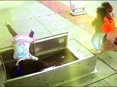 خاتون موبائل فون استعمال کرنے کے دوران کئی فٹ نیچے جا گریں