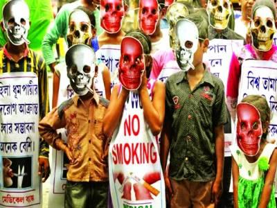 کولکتہ: تمباکو نوشی کے خلا ف مہم میں بچے ماسک پہنے شریک ہیں